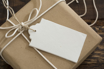gift box wrapped in recycled paper with label