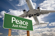 Peace Green Road Sign and Airplane Above