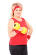 Mature woman in sportswear lifting a dumbbell
