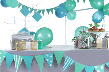 Blue and green colored birthday party table