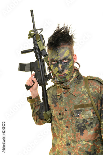 Airsoft player isolated on white