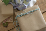 gift box wrapped in recycled paper with green ribbon bow