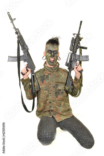 Airsoft player with BB pistol