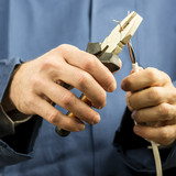 Technician or electrician working with wiring