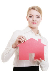 Business woman real estate agent holding red paper house