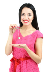 Attractive young woman with pendant in hands isolated on white