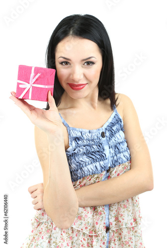 Attractive young woman with gift isolated on white