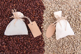 Sacks with coffee on coffee beans background