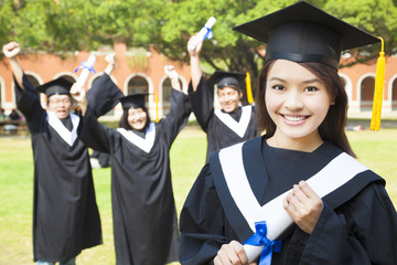 college graduate with happy classmates