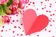 Paper heart with flowers on bright background