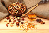 Sweet honey and different nuts on wooden table