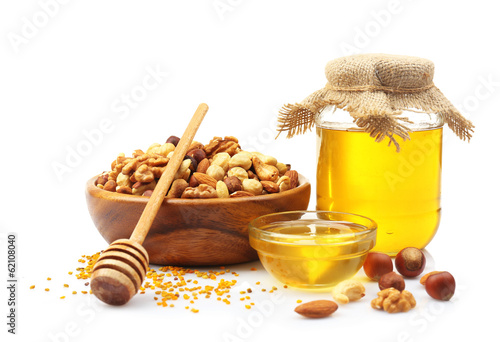 Sweet honey and different nuts, isolated on white