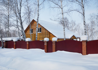 Residential house in the winter forest