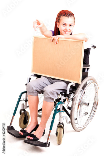 Invalid girl on wheelchair isolated on white