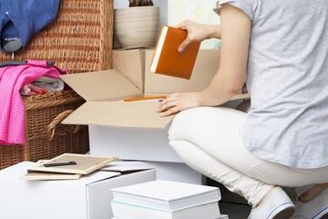 Woman packing house stuff