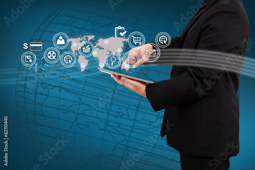 Businessman showing map and icon application on virtual screen.