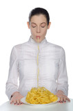 Woman with closed eyes eating pasta