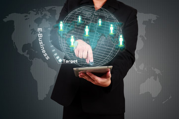 Businessman holding tablet and touching a target on virtual scre