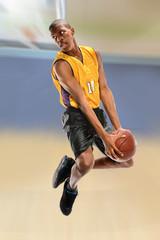 Basketball Player Dunking Ball