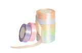 pastel colored satin ribbons on spools Isolated