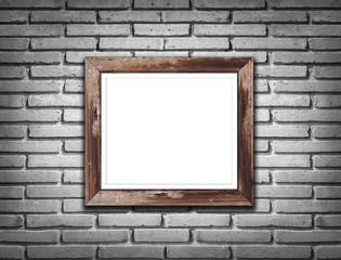 Picture wood frames on brick wall