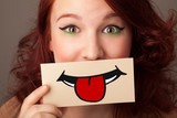 Happy pretty woman holding card with funny smiley - 62112400