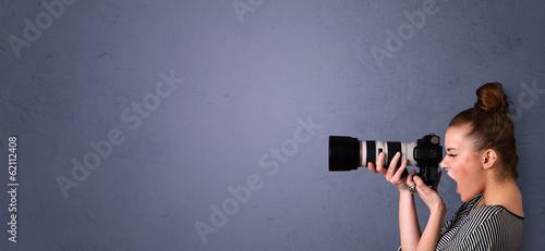 Leinwanddruck Bild Photographer shooting images with copyspace area