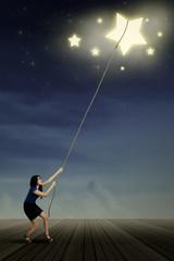 Asian woman taking stars