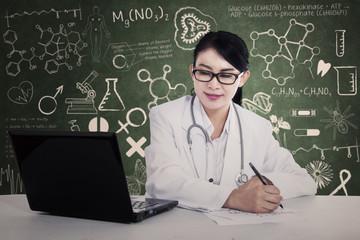 Beautiful doctor writes formula
