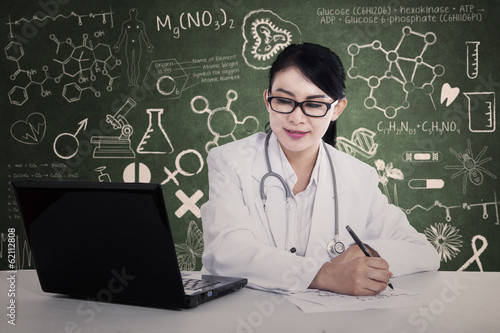 Beautiful doctor writes formula