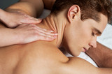 Young man getting spa massage
