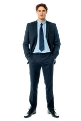 Young businessperson posing with hands in pocket