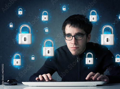 Young hacker with virtual lock symbols and icons