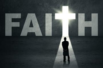 Businessman looking at faith door