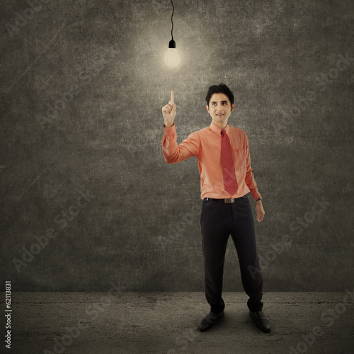 Businessman having a bright idea