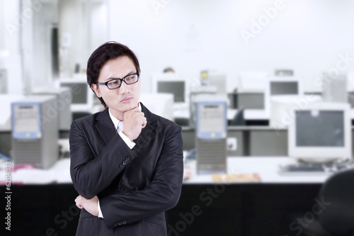 Businessman thinking of idea at office