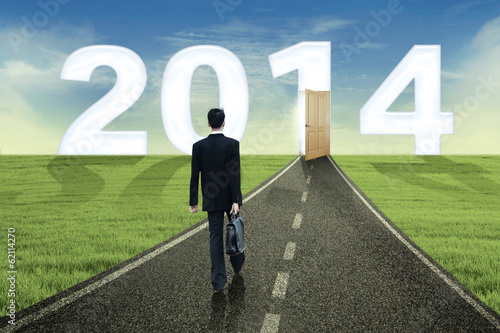 Businessman walks into the future in 2014