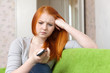Red-haired  teenager girl  having disappointment