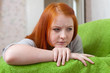 Red-haired unhappy teenager