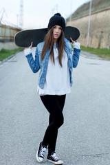 Teenager holding skateboard