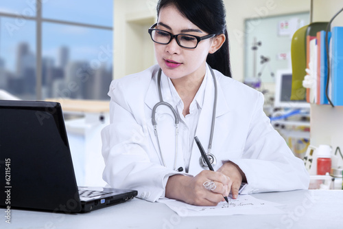 Female doctor writes a prescription
