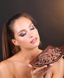 Portrait of beautiful young girl with cocoa beans