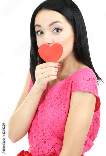Attractive young woman with heart isolated on white