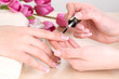 Manicure process in beauty salon close up