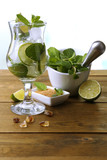 Ingredients for lemonade on wooden table, on nature background