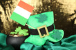 Saint Patrick day hat, pot of gold coins and Irish flag