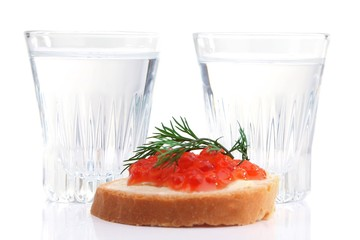 Sandwich with caviar and vodka isolated on white