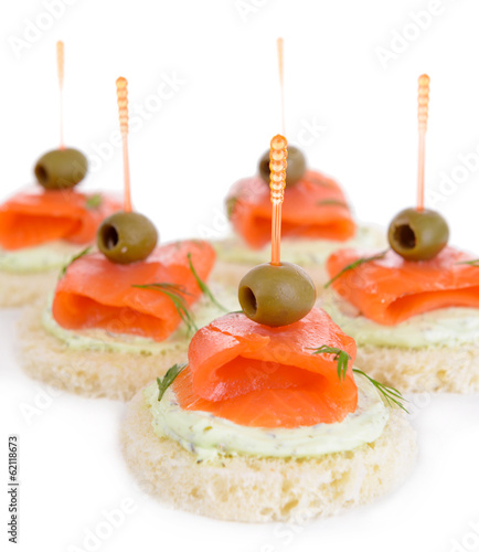 Delicious canapes isolated on white