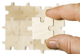 Wooden puzzle on white background. . Close up