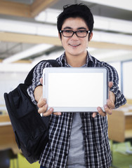 Young man showing digital tablet